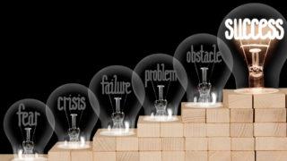 Light Bulbs with Fear, Crisis, Failure and Success Concept