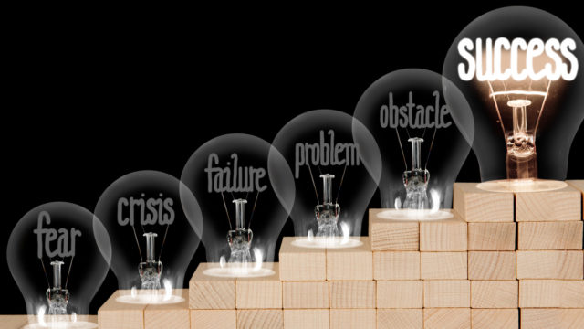 Light Bulbs with Fear, Crisis, Failure and Success Concept