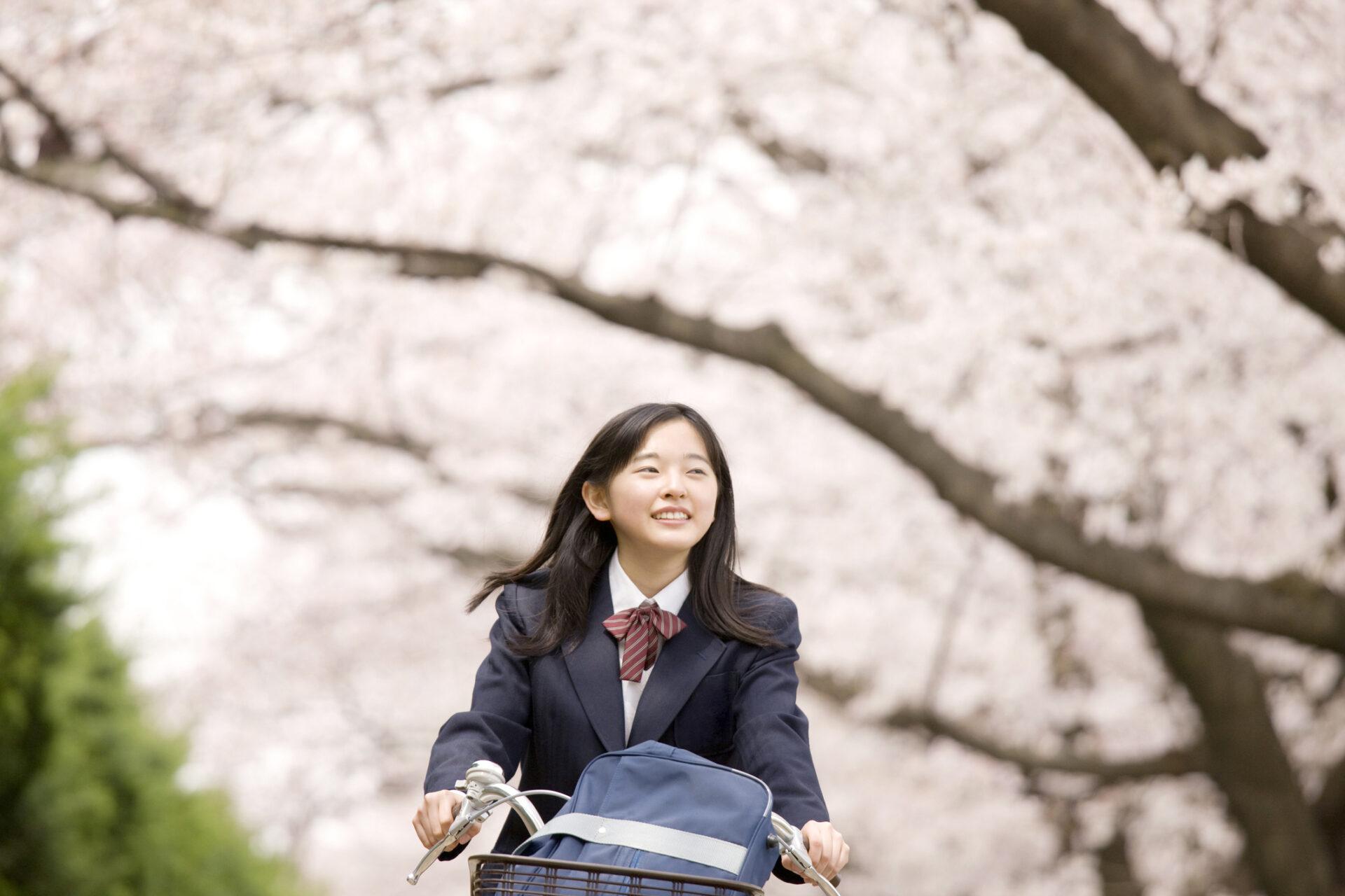 High school girl on a bike